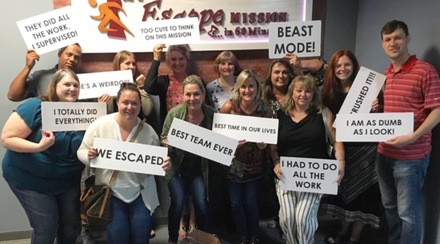 CUES staff team bonding in an escape room