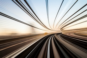Railroad tracks with blurred views signifying speed