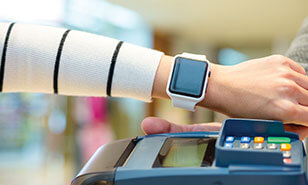 Customer using smartwatch to pay the bill by NFC technology